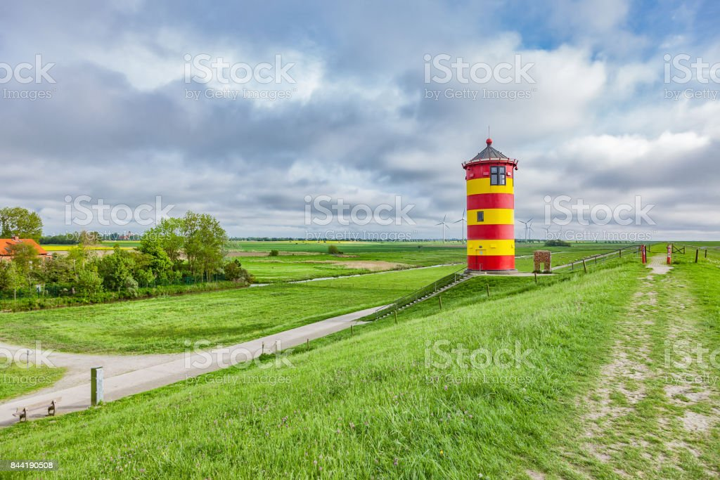 The Pilsum lighthouse on the North Sea coast of Germany. stock photo