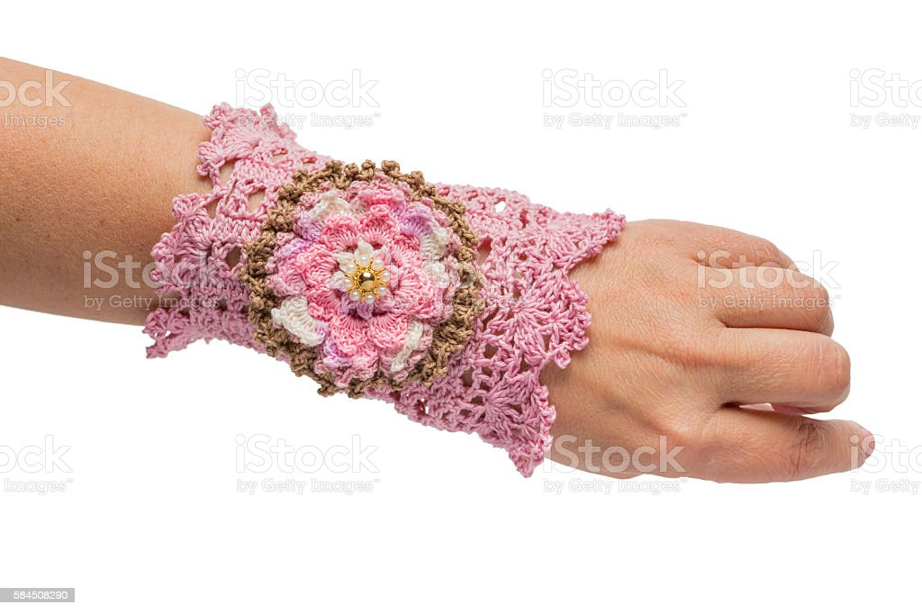 The pink bracelet embroidered with threads stock photo
