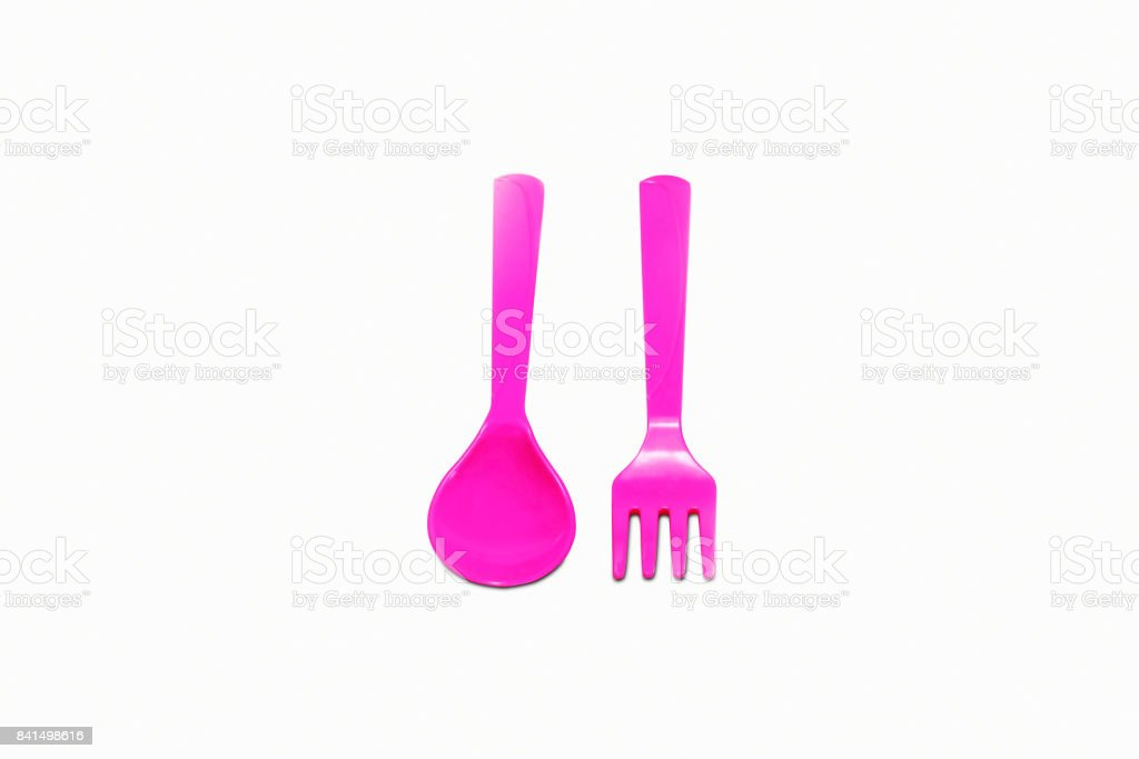 The pink plastic spoon and fork isolate stock photo