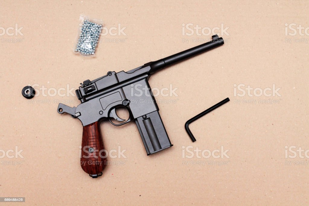 The pistol is in the charged position. Officer's pistol. A pistol with a clip. stock photo