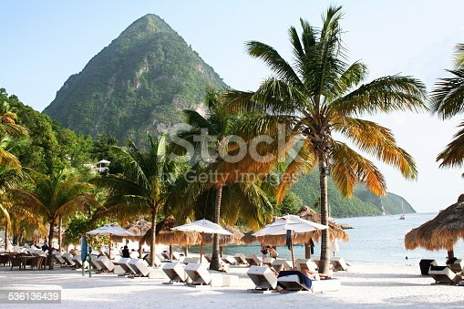 A boat is moared in the harbour mouth of the Pitons in St Lucia.