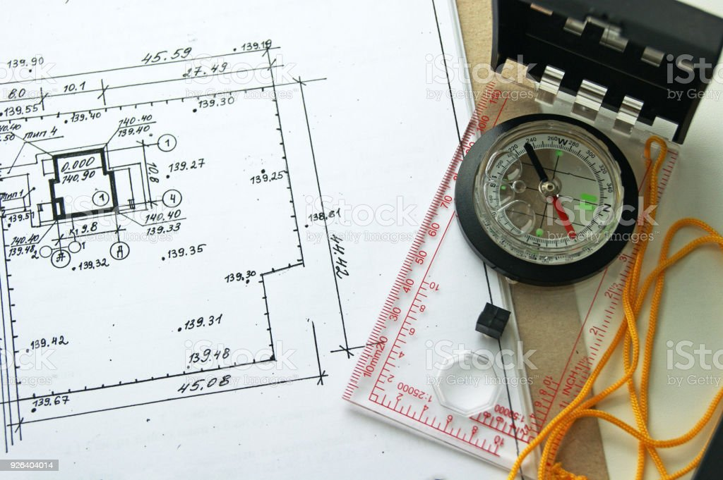 The plan is a project of a residential attic house. Compass next to the drawing stock photo