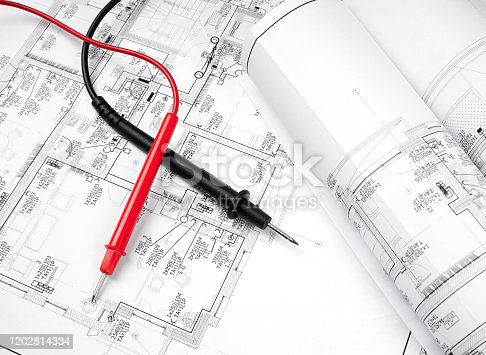 High angle view on the plan of electrical installation and cables of multimeter