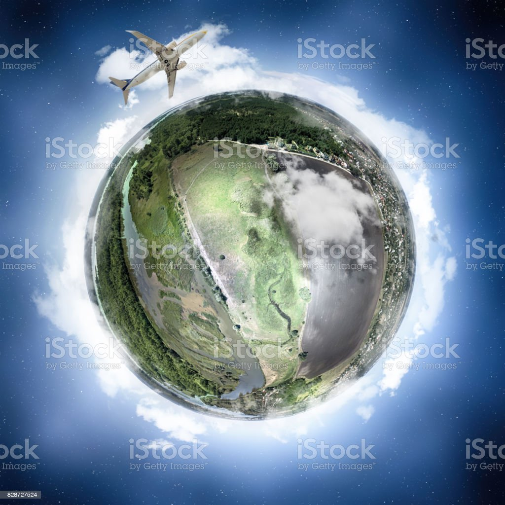The plane flies around the earth (miniature planet concept) stock photo
