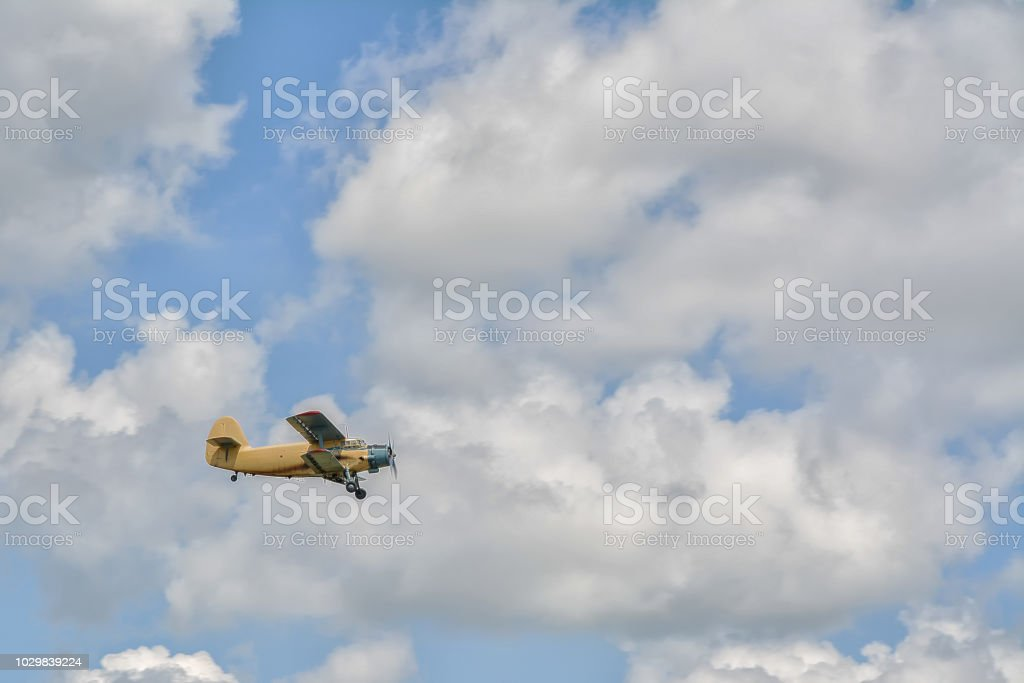 the plane is a crop duster in the sky stock photo