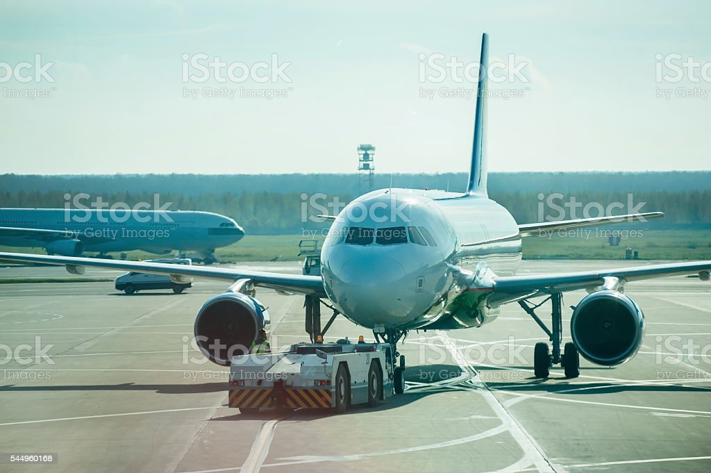 The plane on the runway. stock photo