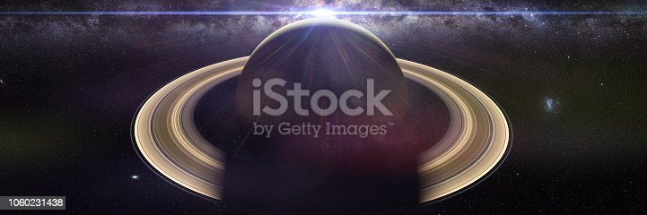 istock the planet Saturn with the Sun and the galaxy 1060231438