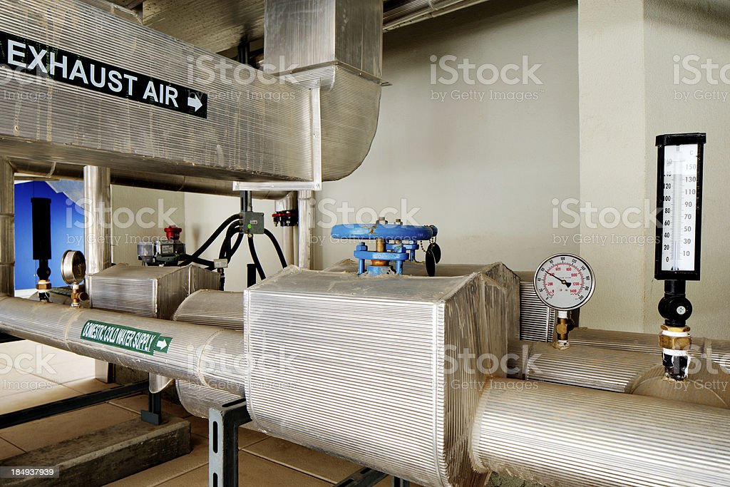 The plant room pipes and ducts stock photo