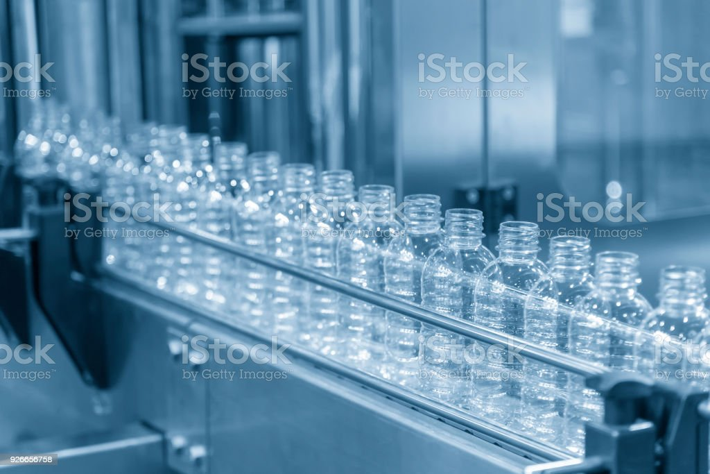 The plastic bottle in the conveyer at the water drinking factory stock photo