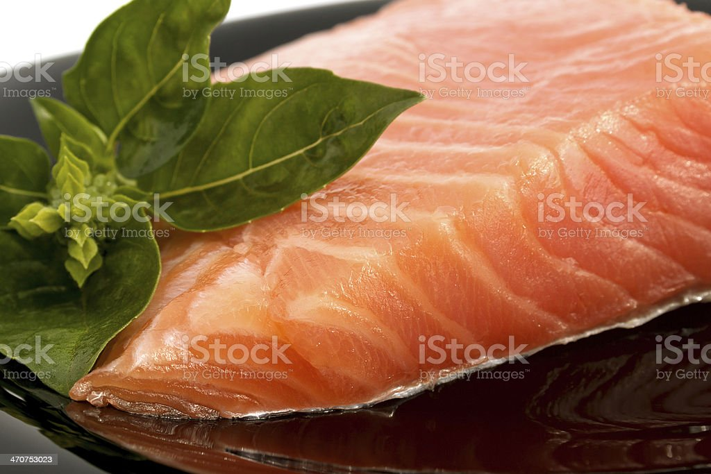 The plate with appetizing salmon and  sprig of basil stock photo