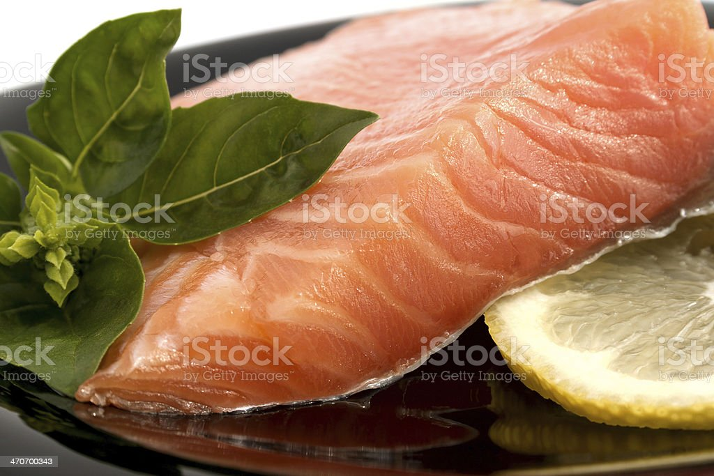 The plate with appetizing salmon, basil and lemon stock photo