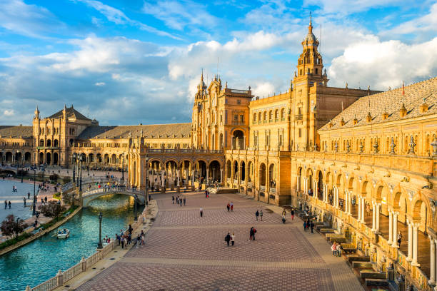 The Plaza de Espana in Parque de María Luisa with many tourist, Seville, Spain Spain Square in Parque de María Luisa with many tourist, Seville, Spain seville stock pictures, royalty-free photos & images