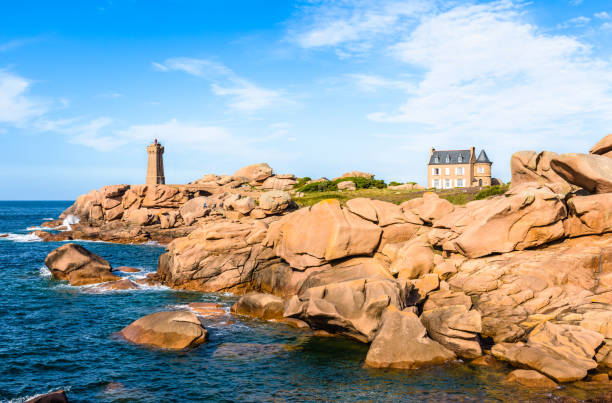 The Ploumanac'h lighthouse on the Pink Granite Coast in northern Brittany, France. - Photo