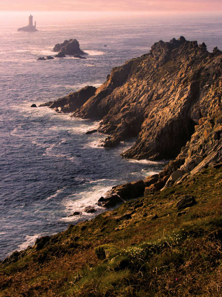 The Pointe du Raz is a promontory that extends into the Atlantic from western Brittany, in France. stock photo