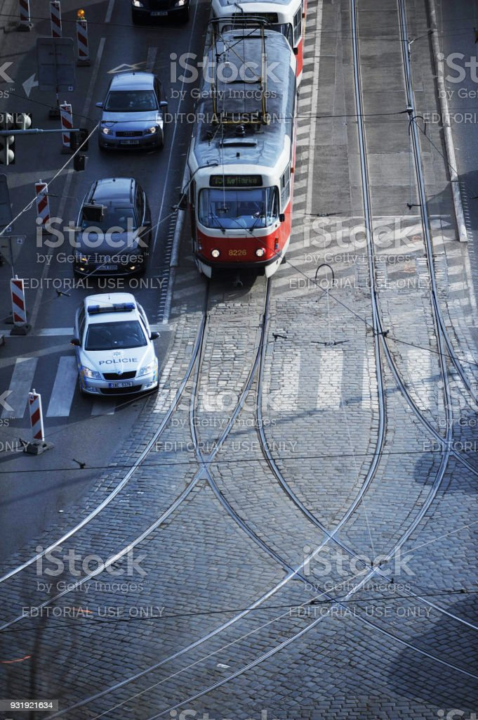 The Police Car Overtakes the Tram Number 15 on the Stefaniks Bridge (tefánikv Most) over Vltava River. stock photo