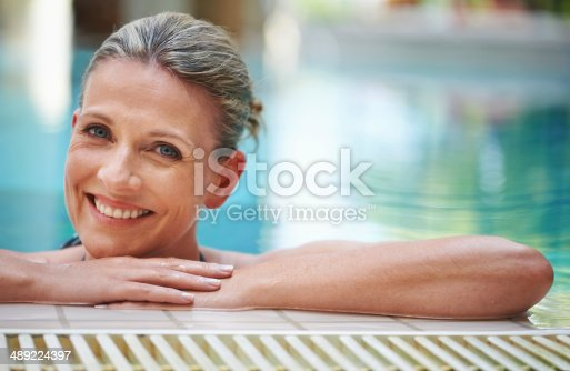 Portrait of a mature woman in an indoor swimming pool