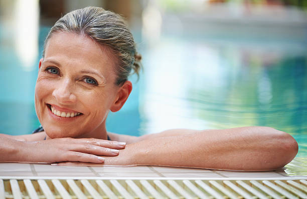 the pool is perfect for a pick-me-up - older women bikini stock pictures, royalty-free photos & images