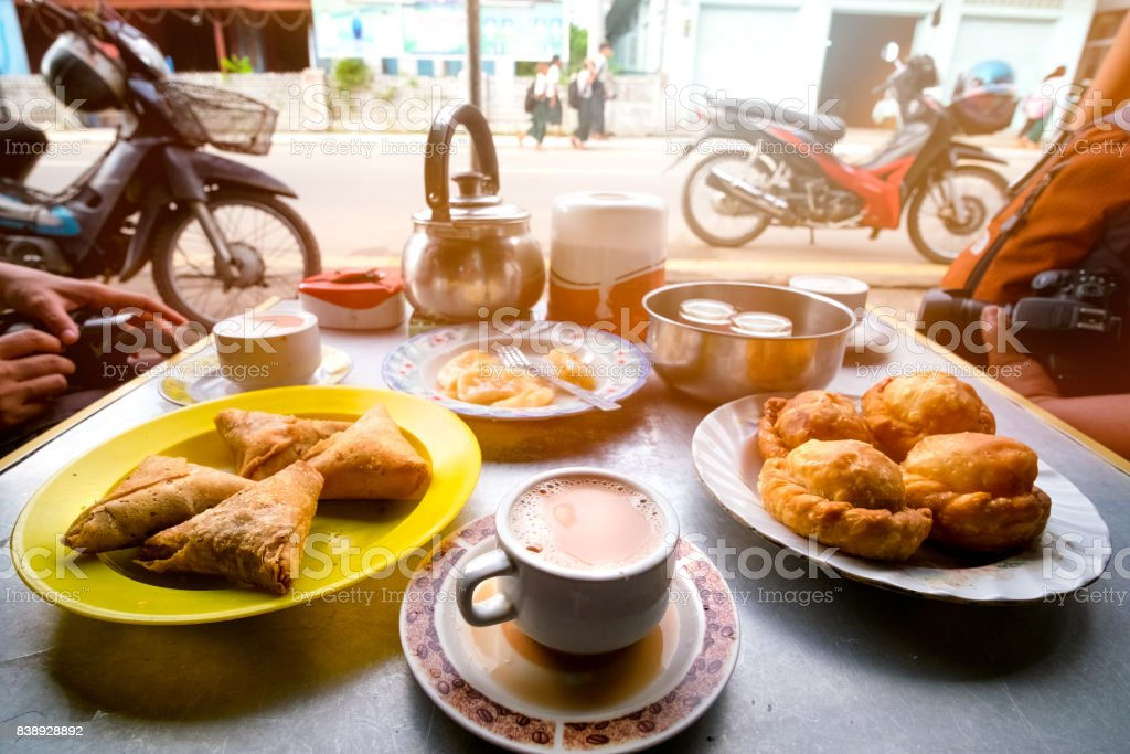 the popular breakfast in Dawei Myanmar is milk tea, curry puff, samosa, roti topped with sweetened condensed milk. stock photo