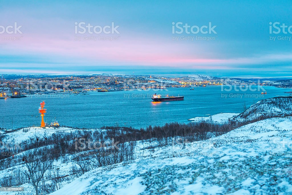 The port city of Murmansk in the evening. stock photo