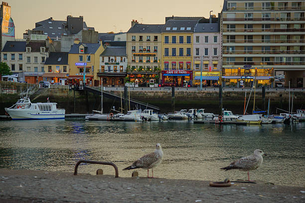 The port in Cherbourg Cherbourg, France - September 21, 2012: Sunset view of the port in Cherbourg, Normandy, France cherbourg stock pictures, royalty-free photos & images