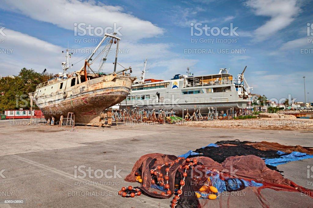 The port of Ortona, Abruzzo, Italy with boat repayr shipyard stock photo