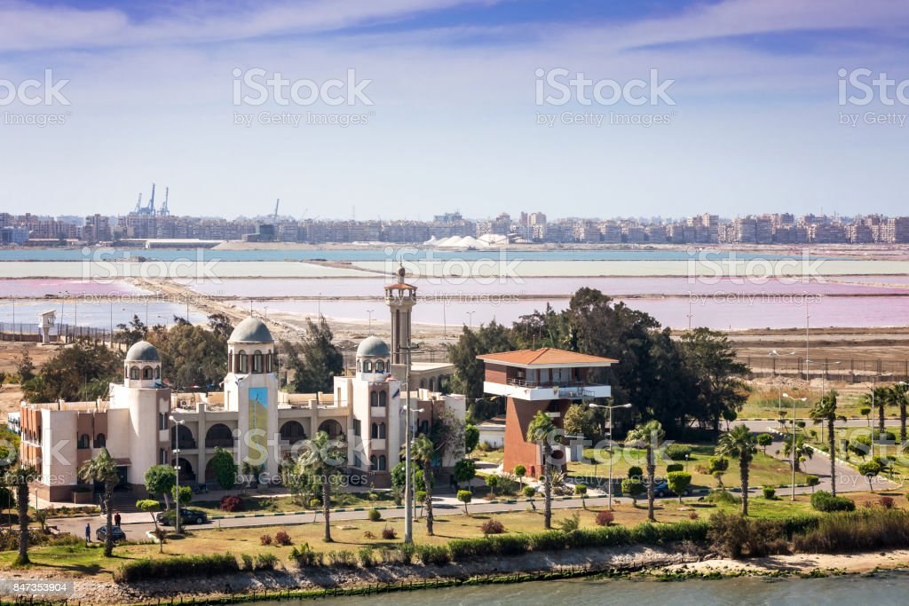 The port towns of Port Said and Port Fouad with salt mines and small mosque on the Suez Canal stock photo