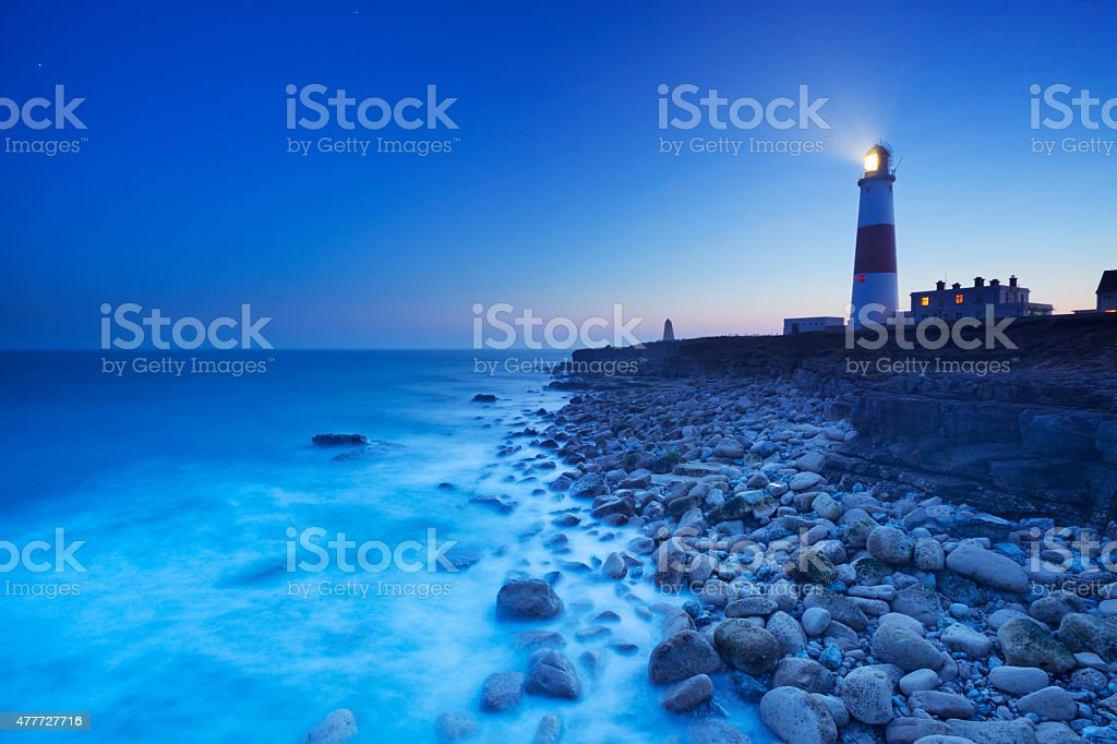 The Portland Bill Lighthouse in Dorset, England at night stock photo