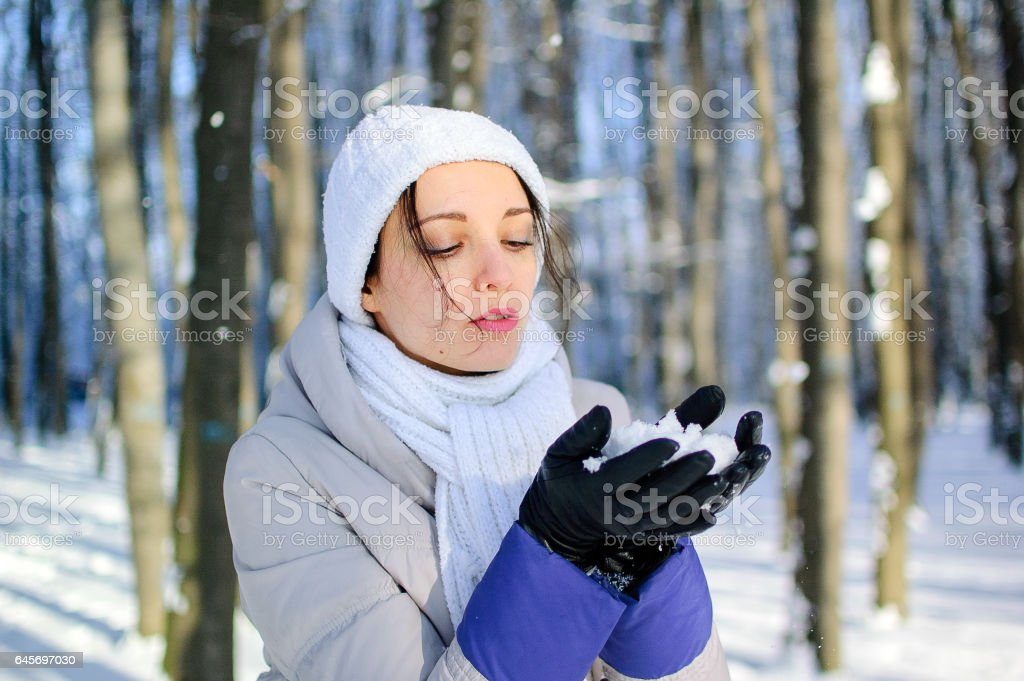 The portrait of a girl in white knitted hat stock photo