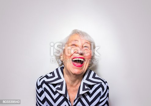 istock The portrait of a laughing old woman 803339540
