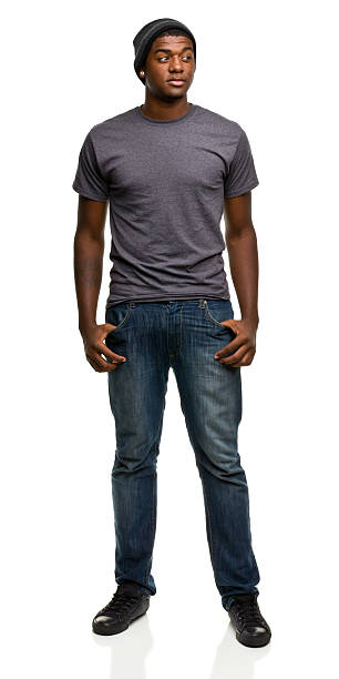The portrait of a young black man, on jeans and a grey shirt stock photo