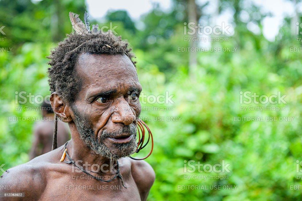 The Portrait of the Korowai man stock photo