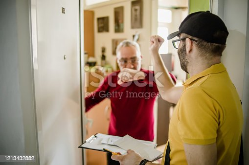 Postar brings a package to the door. Older man receives a letter