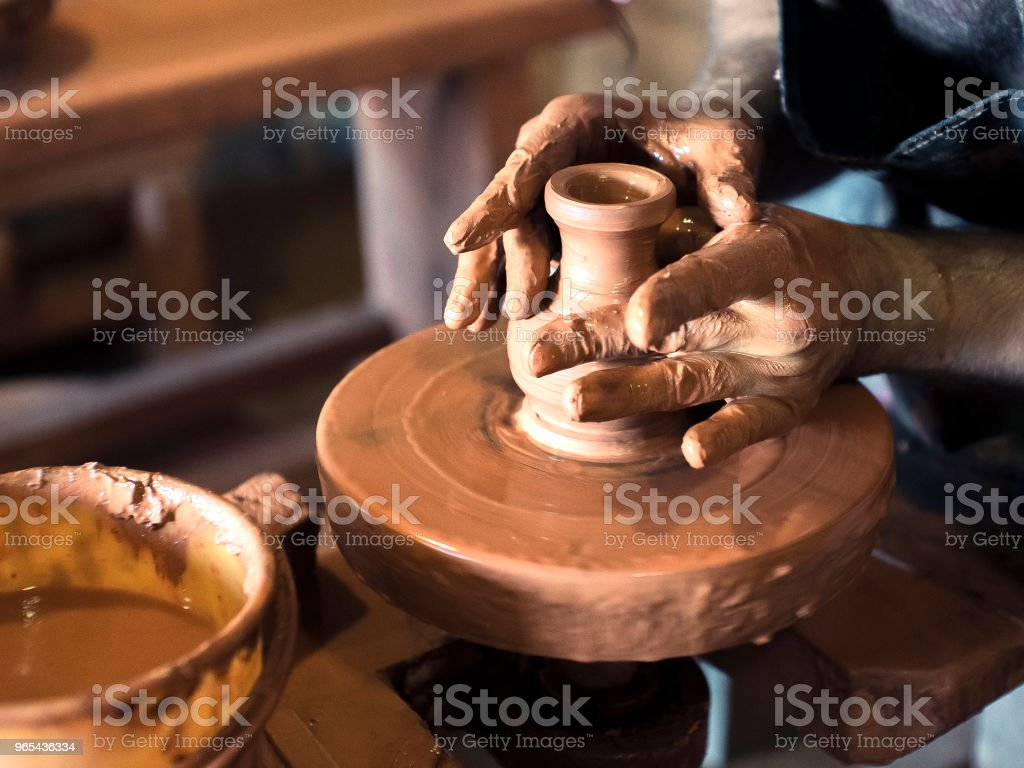 Pottery circles with his own hands. Potter&#39