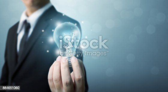 175442264 istock photo The power of creativity, technology, innovation or new business to success in the future concept, Businessman holding light bulb 884651060