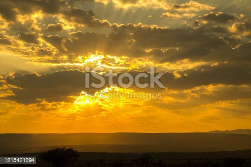 the power of god manifested in the beauty of nature, stillness and calm in a cloudy sunset full of sun rays