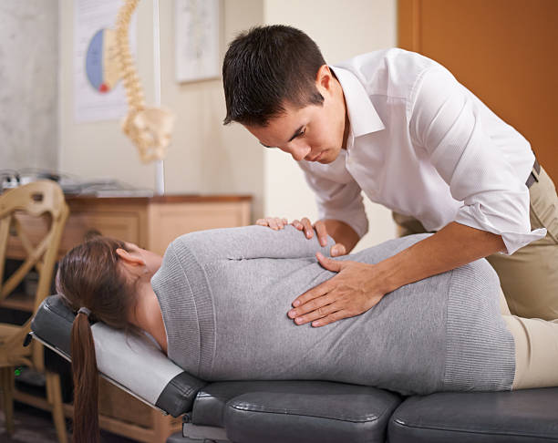 the power that made the body, heals the body - chiropractic care stock photos and pictures