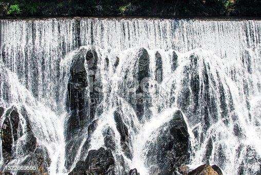 """istock The powerful Nagashino Entei and spillway (Yosuibaki), also known as """"Niagara Falls in Aichi"""". 1322669595"""