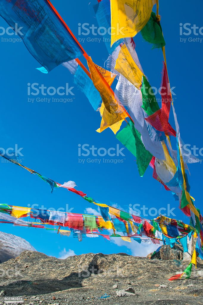 The prayer flags fluttering in the mountains of Tibet stock photo