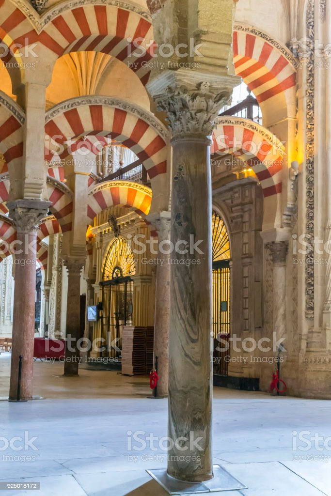 The prayer hall inside of The Mosque–Cathedral of Córdoba stock photo