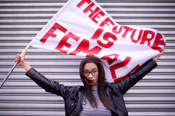 the present is female, the future is female - protestor stock pictures, royalty-free photos & images
