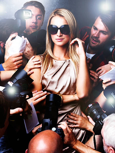 The pressure of fame Portrait of a young celebrity surrounded by paparazzi photographers diva human role stock pictures, royalty-free photos & images