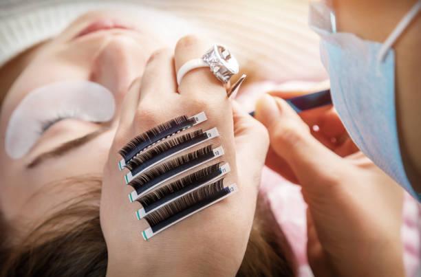 The procedure of eyelash stock photo