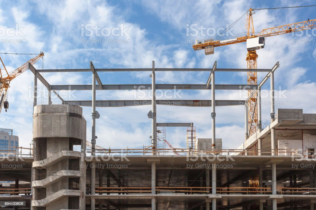 The process of building multi-storey parking for cars. Concrete interior of unfinished parking area stock photo