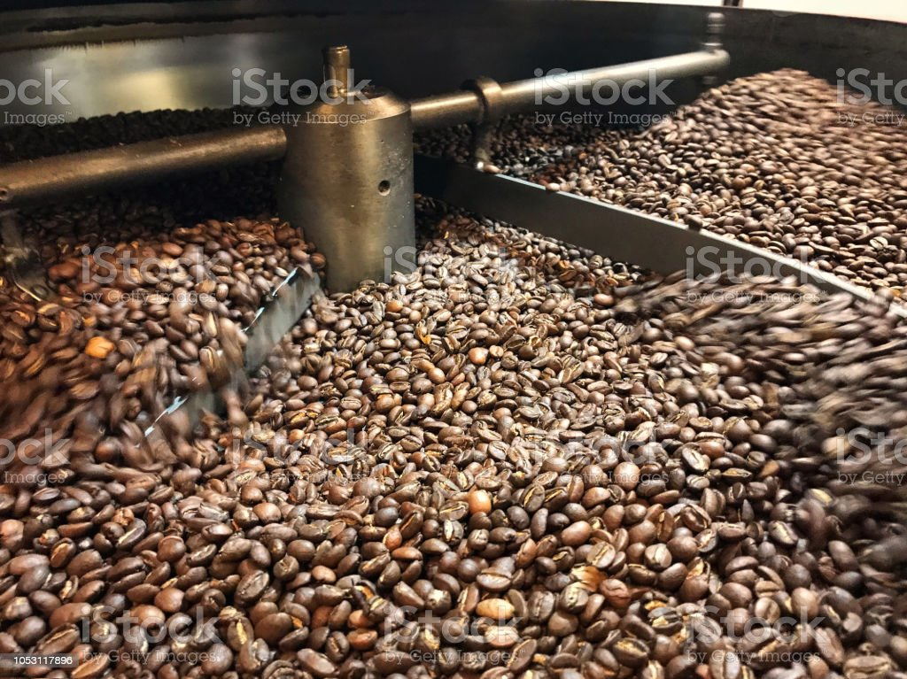 The process of cooling coffee beans after roasting. Background. Texture. stock photo