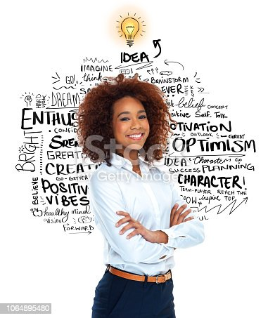 Portrait of an attractive young woman standing with her arms folded against a white background displaying vector images of the concept of idea generation