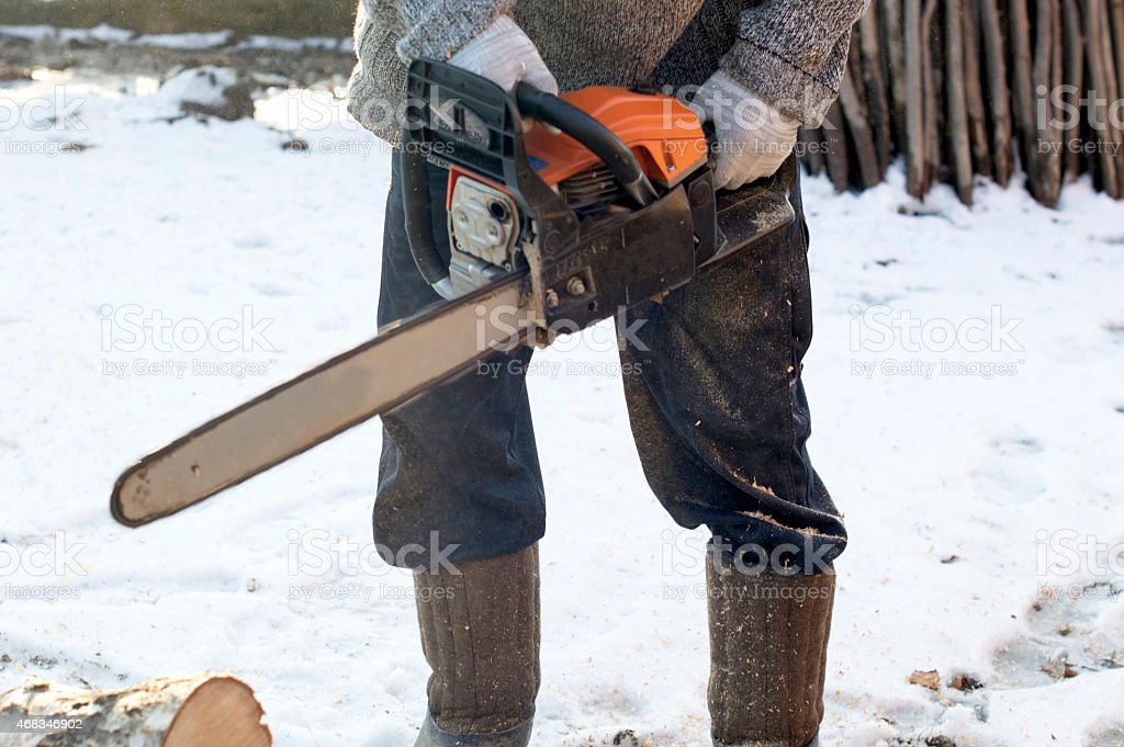The process of cutting wood using a chainsaw royalty-free stock photo