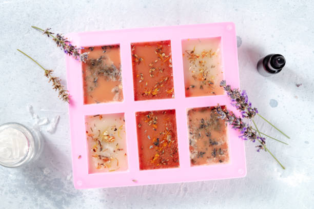 The process of making handmade soap. Glycerin with herbs, poured into a special mold for drying stock photo