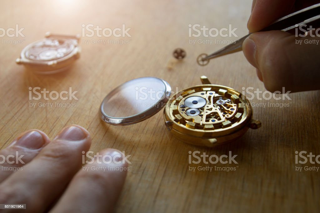 The process of repair of mechanical watches stock photo