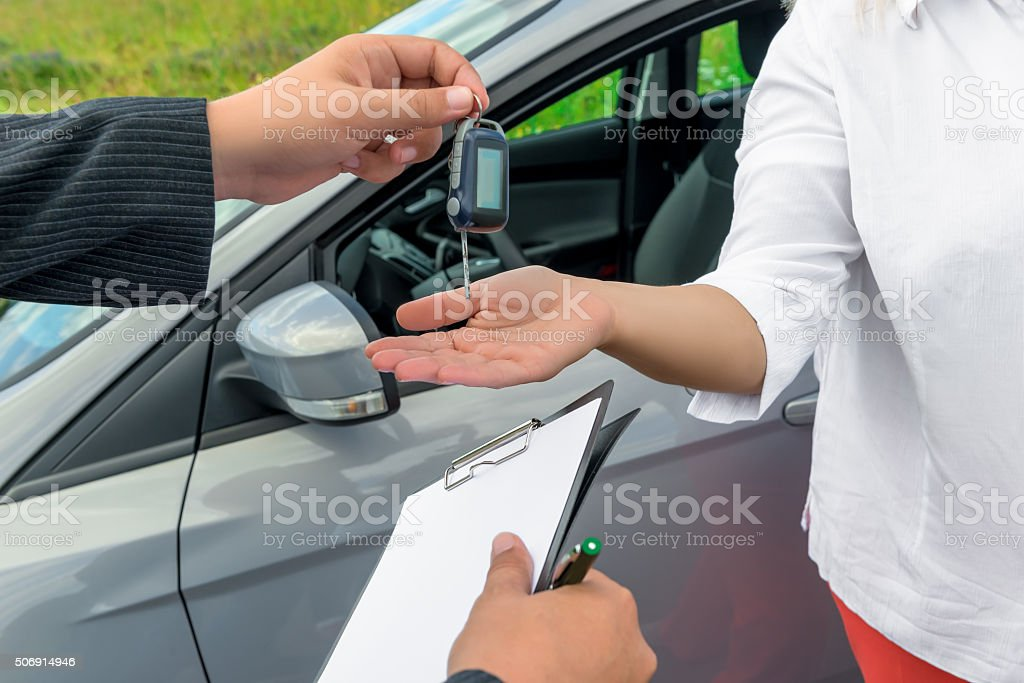 the process of transferring keys to the new owner stock photo