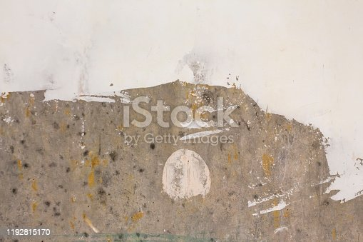 639291528istockphoto the process of updating gray concrete walls with putty 1192815170